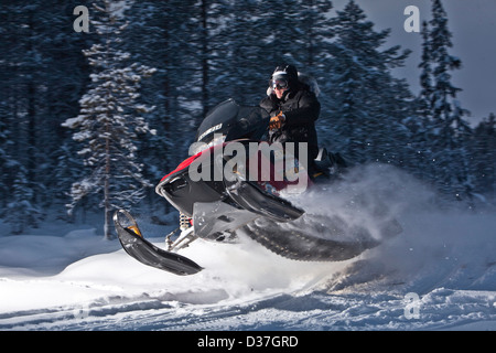 Snowmobile action, jumping on snow - Stock Photo