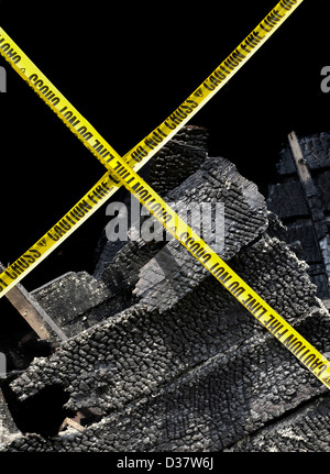 Home with fire damage and yellow caution tape - Stock Photo