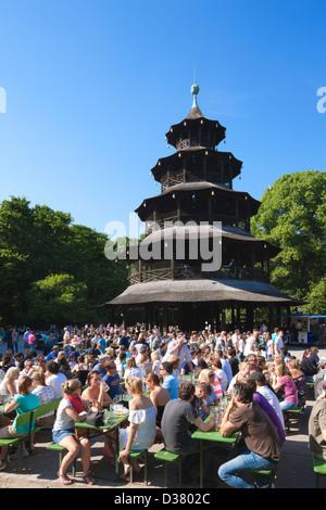 People drinking in The Chinese Tower beer garden, Englischer Garten, Munich, Bavaria, Germany - Stock Photo
