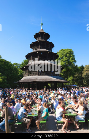People drinking in The Chinese Tower beer garden, Englischer Garten, Munich, Bavaria, Germany - Stock Photo