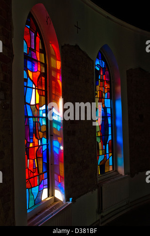 Contemporary stained glass window in what once was a Catholic Seminary, soon to be redeveloped into modern luxury - Stock Photo