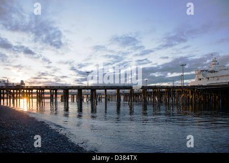 Ferry loading at sunset, Deep Water Dock, Homer Spit, Homer, Alaska, USA - Stock Photo