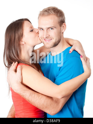 happy young couple - girl kissing boy, embracing - isolated on white - Stock Photo
