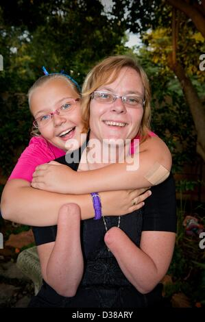 VEREENIGING, SOUTH AFRICA: Elize Henwood and her daughter, Elzandre, on February 2, 2013, in Vereniging, South Africa. - Stock Photo