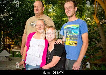 VEREENIGING, SOUTH AFRICA: Elize Henwood her daughter Elzandre, her husband Alex and their son, on February 2, 2013, - Stock Photo