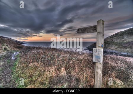 Footpath sign on Ceredigion coastal path at Mwnt beach - Stock Photo