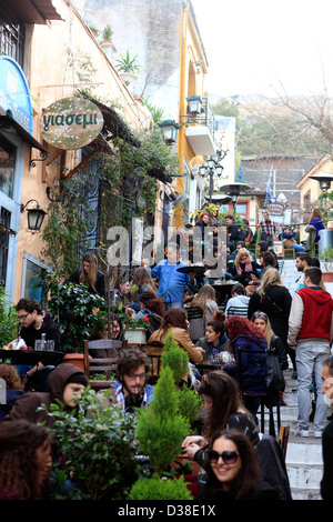 greece athens plaka mnisikleous street giasemi cafe and bistro crowded with students in winter - Stock Photo