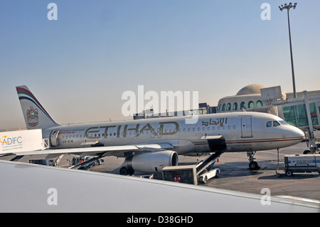 plane of Etihad airways Airbus A 320 Abu Dhabi international airport - Stock Photo