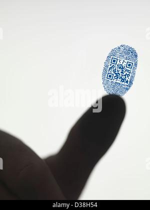 Finger leaving QR code in fingerprint - Stock Photo