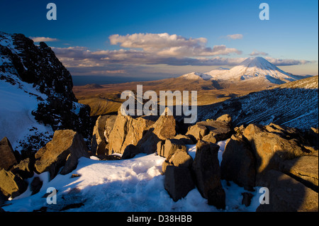 Shadows over rocks in snowy landscape - Stock Photo