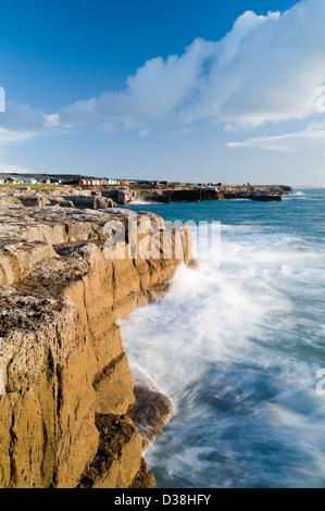 Waves crashing on cliffs - Stock Photo