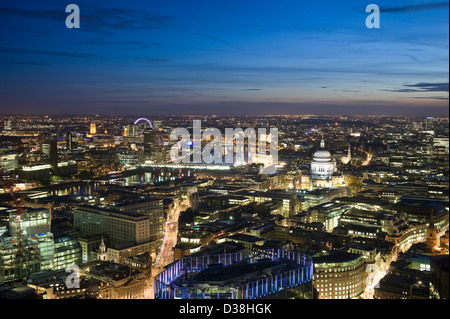 Aerial view of cityscape lit up at night - Stock Photo