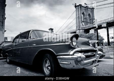 Vintage car parked by city bridge - Stock Photo