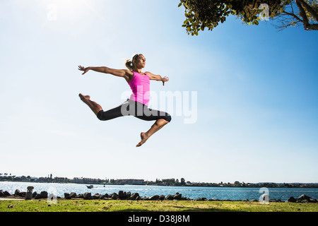 a woman with legs in the air stock photo  alamy