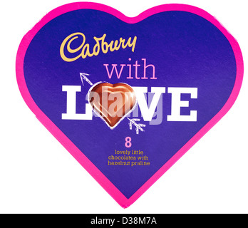 Heart shaped box of Cadbury heart shaped hazelnut praline chocolates - Stock Photo