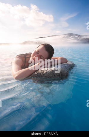 Woman relaxing in thermal lake - Stock Photo