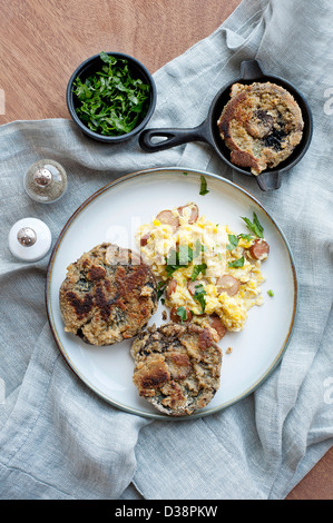 Plate of eggs, bread and herbs - Stock Photo