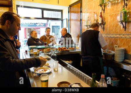 casa revuelta madrid spain bar beer men cod - Stock Photo