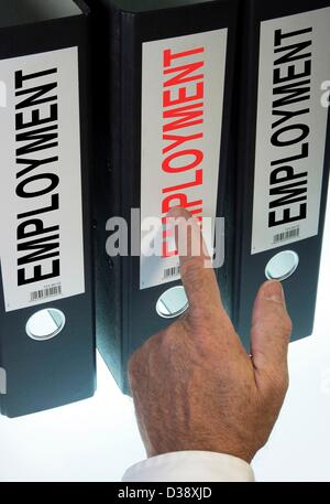Symbol image,hand pointing to a file folder  labeled Employment - Stock Photo