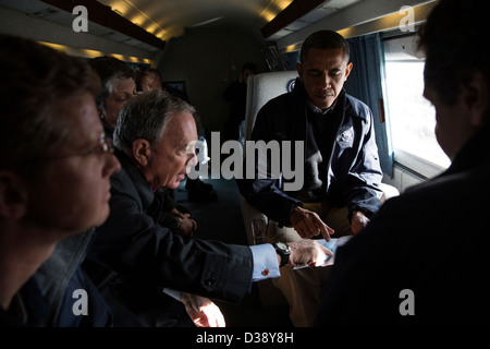 New York City Mayor Michael Bloomberg views a map with the President during an aerial tour to view damage from Hurricane - Stock Photo