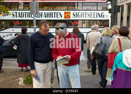 Berlin, Germany, tourists look at a map - Stock Photo