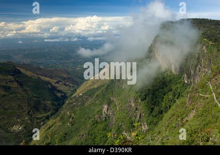 Cloud hanging on the sheer precipice of World's End, Horton Plains National Park, Sri Lanka - Stock Photo