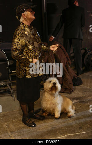 New York City, US, 12 February 2013. A woman waits in the wings with her terrier at the 137th annual Westminster - Stock Photo