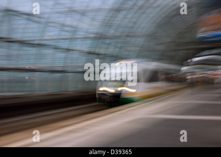Berlin, Germany, traveling by express train on the Berlin Hauptbahnhof - Stock Photo