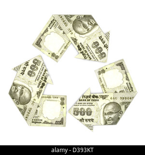Indian five hundred rupee notes in form of recycling symbol - Stock Photo