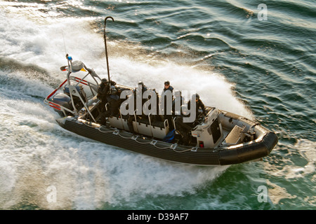 A SWAT -special forces police- inflatable rigid hull (zodiac type) boat at speed on open water - Stock Photo