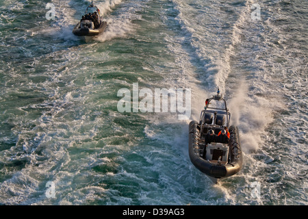 SWAT -special forces police- inflatable rigid hull (zodiac type) boats at speed on open water. - Stock Photo