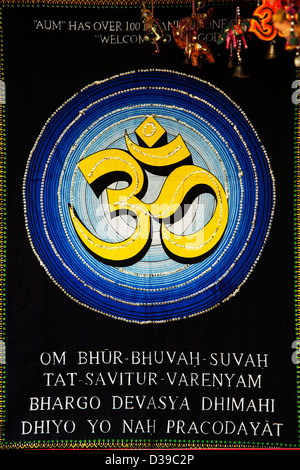 OM , AUM , with Gayatri Mantra on a Indian wall hanging - Stock Photo
