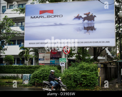 Smoking advertisement still allowed in Indonesia. - Stock Photo