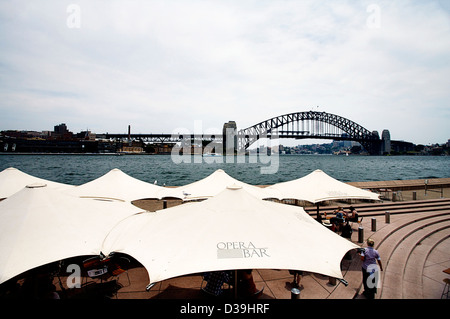 The Sydney Harbor Bridge, Sydney, NSW, Australia as seen from the promenade at the Sydney Opera House Bar Cafe - Stock Photo