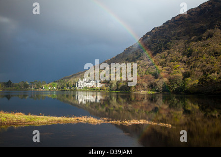 Rainbow over Kylemore Abbey, Connemara, County Galway, Ireland. - Stock Photo