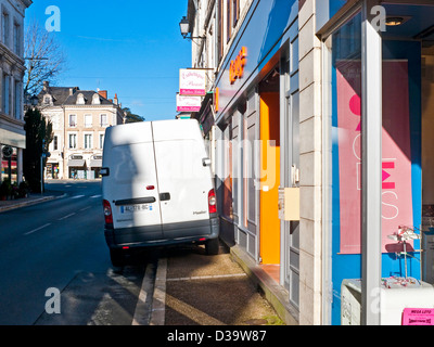 White van badly parked blocking pavement - France. - Stock Photo