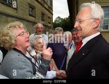 Bavarian Prime Minister and leader of the CSU party Edmund Stoiber jokes with members of a travelling group at cloister - Stock Photo