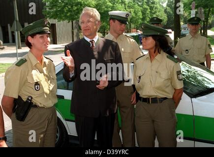Bavarian Prime Minister and leader of the CSU party Edmund Stoiber talks to police officers in Munich, May 14, 1998. - Stock Photo
