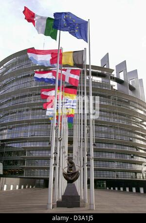 (dpa) - The flags of the 15 EU member states are fluttering in front of the building of the European Parliament - Stock Photo