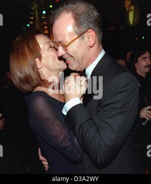 (dpa files) - German Defence Minister Rudolf Scharping and his companion Kristina Countess Pilati-Borggreve are dancing with their arms tightly round each other at the Sports Press Ball in Frankfurt/Main, 4 November 2000. Scharping was dismissed by Chancellor Gerhard Schroeder 18 July 2002 following