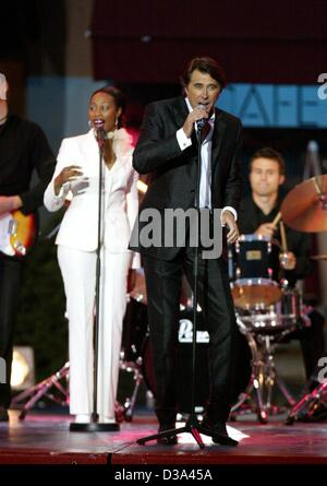 (dpa) - Pop singer Bryan Ferry performs with his band during a live broadcast of a German TV show 'Wetten, dass - Stock Photo