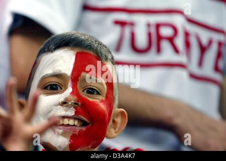 (dpa) - A supporter of the Turkey soccer team has painted his face in the national colours and is waiting for the - Stock Photo