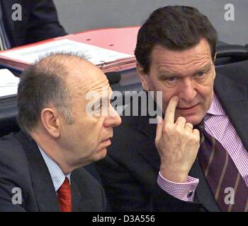 (dpa files) - German Labour Minister Walter Riester (L) and Chancellor Gerhard Schroeder have a serious conversation as they sit next to each other in German parliament, the 'Bundestag', in Berlin, 5 April 2001.
