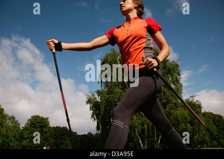 Woman hiking in park - Stock Photo
