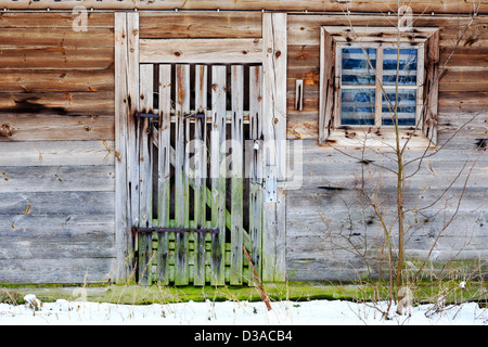 Old door and window of wooden building - Stock Photo
