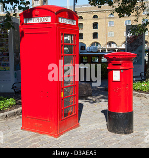 A traditional red English public phone and post box - Stock Photo