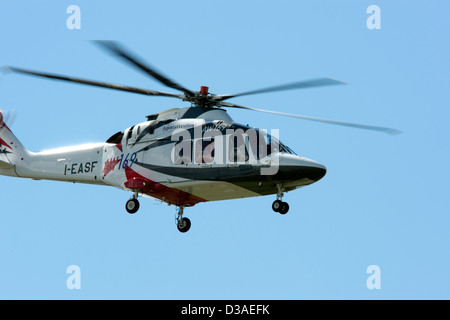 Agusta Westland helicopters flying during the Farnborough Airshow in England - Stock Photo