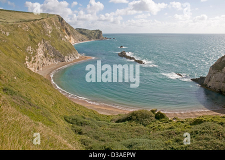 St Oswald's Bay near Lulworth on the Dorset coast, looking east towards Dungy Head in the distance - Stock Photo