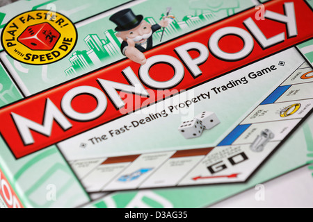 The box of a Monopoly board game. - Stock Photo