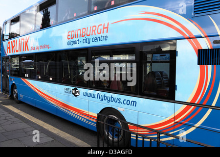 An Airlink bus between Edinburgh City Centre and the Airport, Scotland, UK - Stock Photo